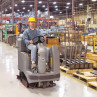 "Advance Adgressor® 3220D Industrial 32"" Ride on Floor Scrubber in Use"