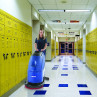 Clarke® CA30™ 20B Auto Scrubber Cleaning a School Floor with a Red Pad